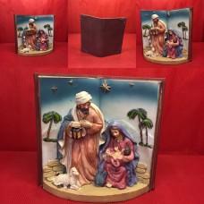 Nativita' nel libro in ceramica ( H17x16 cm)